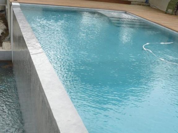 Produit d 39 tanch it des r servoirs citernes et piscines hors sol arcac - Piscine hors sol resine ...